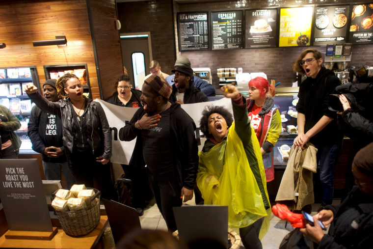 Image: Protesters demonstrate inside a Center City Starbucks in Philadelphia