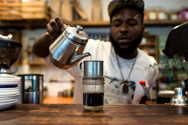Image: Barista Donnell Powell prepares a Vietnamese coffee at Franny Lou's Porch in Philadelphia on May 22, 2018.