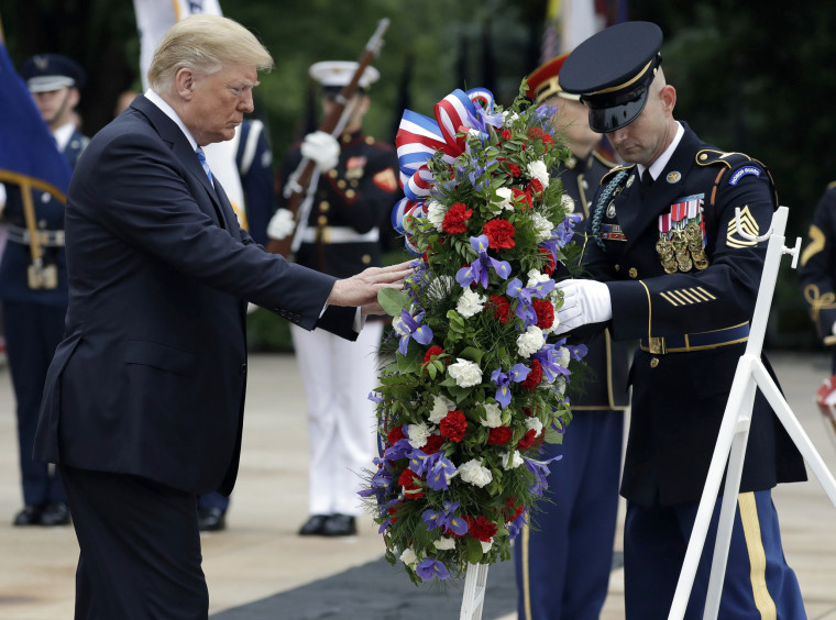 Image: President Donald Trump lays a wreath at the Tomb of the Unknown Solider at Arlington National Cemetery, Monday, May 28, 2018, in Arlington, Virginia.