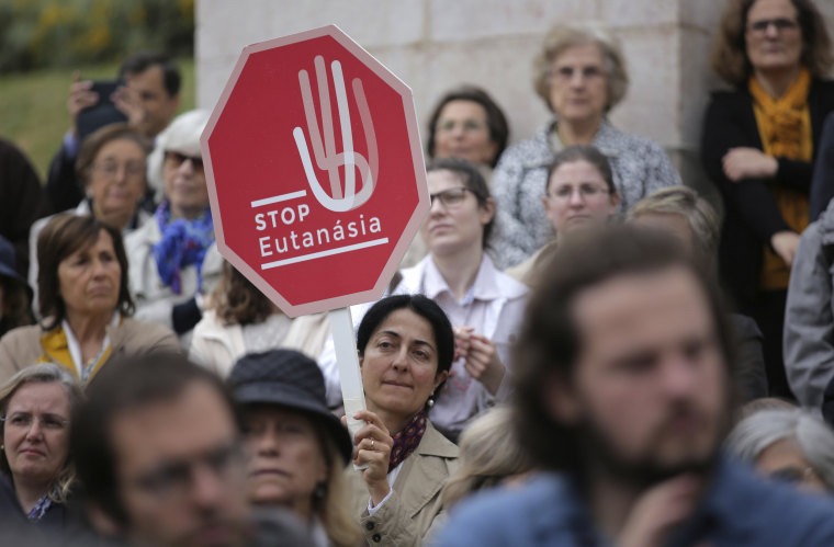 Anti-euthanasia protesters gather in Lisbon on May 24.