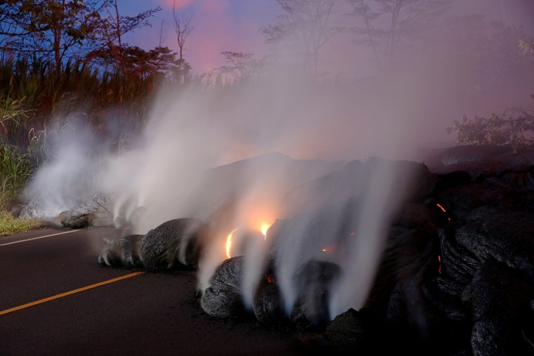 Image: Volcanic gases rise from the Kilauea lava flow near Pahoa, Hawaii