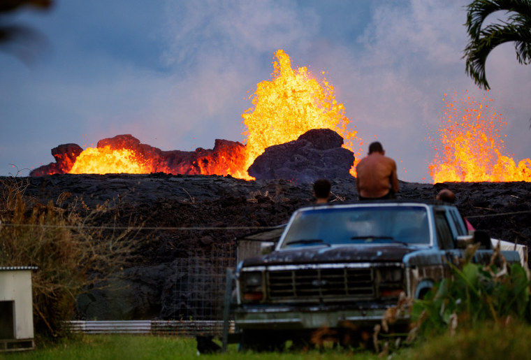 Image: Residents watch lava fountains erupt from a fissure in their friend's backyard