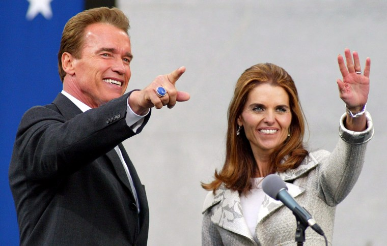 Image: Then California Governor Arnold Schwarzenegger and his wife Maria Shriver wave after the finish of his Inauguration ceremony at the Capitol in Sacramento, California, Nov. 17, 2003.