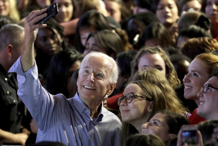 Former Vice President Joe Biden takes a selfie with students