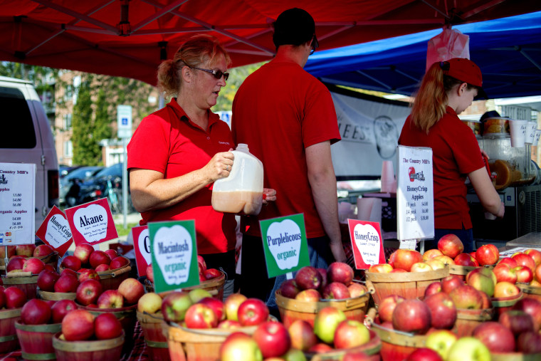 Image: Country Mill Farms employees sell products on Sept. 17, 2017, at the East Lansing Farmer's Market in East Lansing, Michigan.