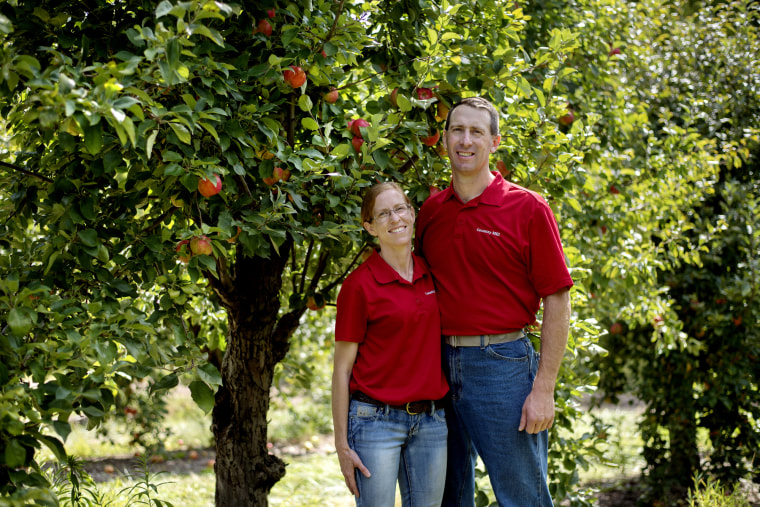 Image: Country Mill Farms owner Steve Tennes, left, and his wife Bridget are photographed in their orchard on Sept. 13, 2017, in Charlotte, Michigan.