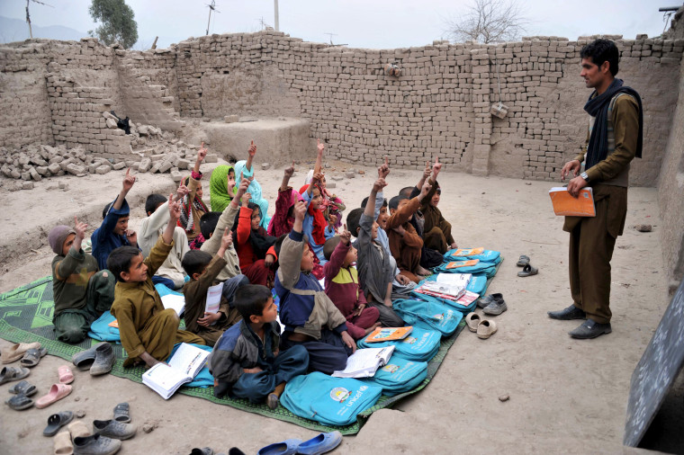 Image: Afghan school children study at an open classroom in the outskirts of Jalalabad on Jan. 30, 2013. Afghanistan has had only rare moments of peace over the past 30 years.