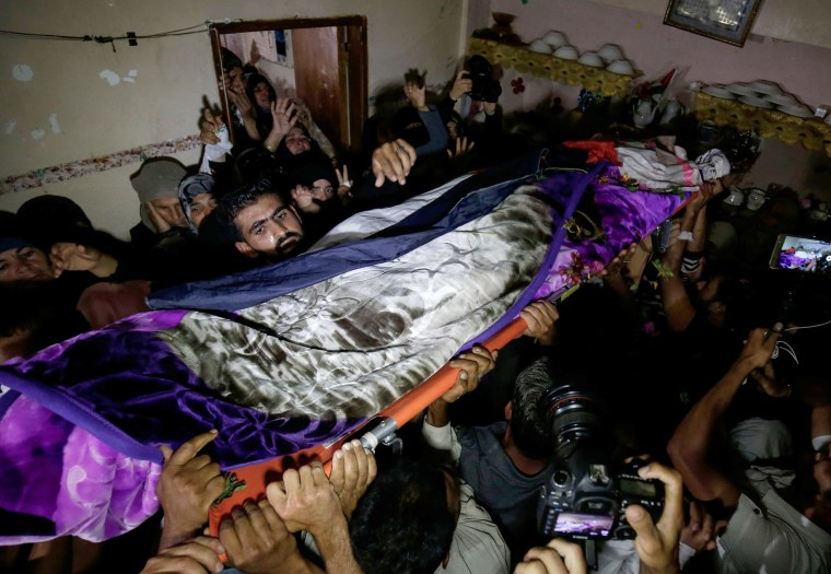 Image: Palestinian mourners carry the body of 21 years old Razan al-Najjar during her funeral after she was shot dead by Israeli soldiers, in Khan Yunis on June 2, 2018.