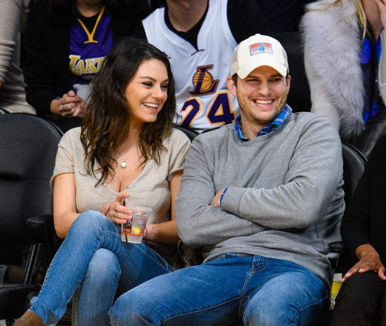 Ashton Kutcher and Mila Kunis at Lakers game