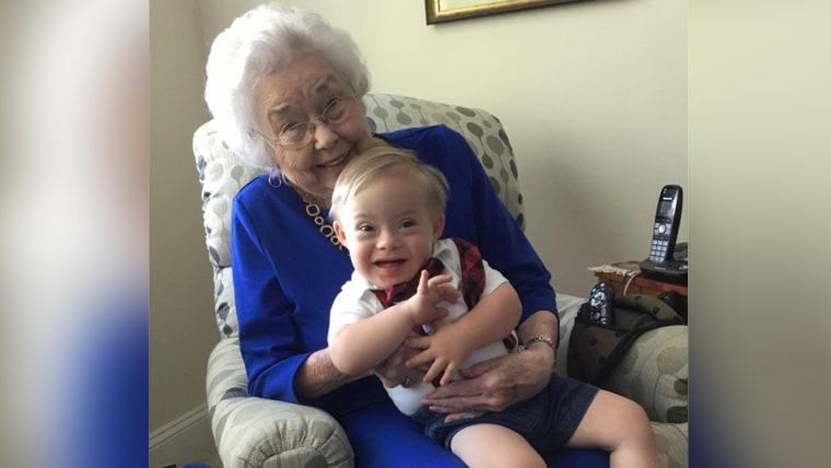 Original Gerber baby holding the new Gerber baby