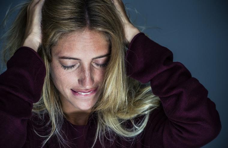 Woman showing regret