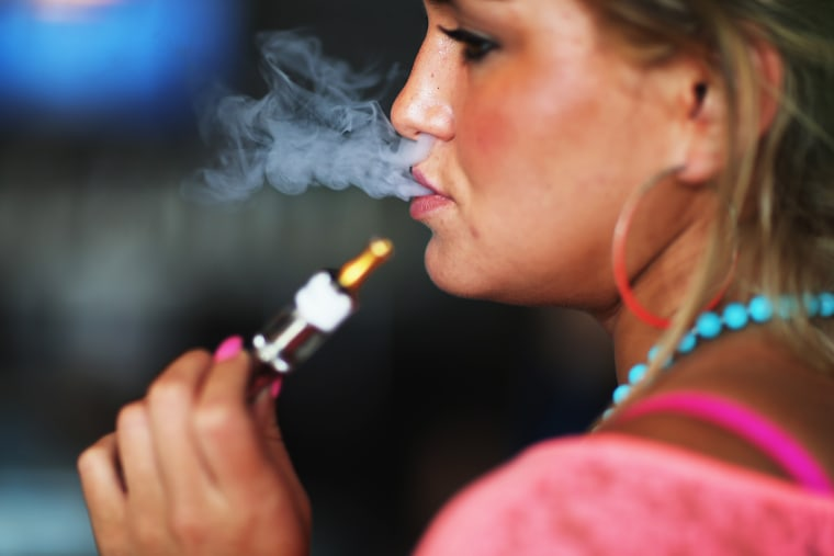 Image: Woman smoking electronic cigarette