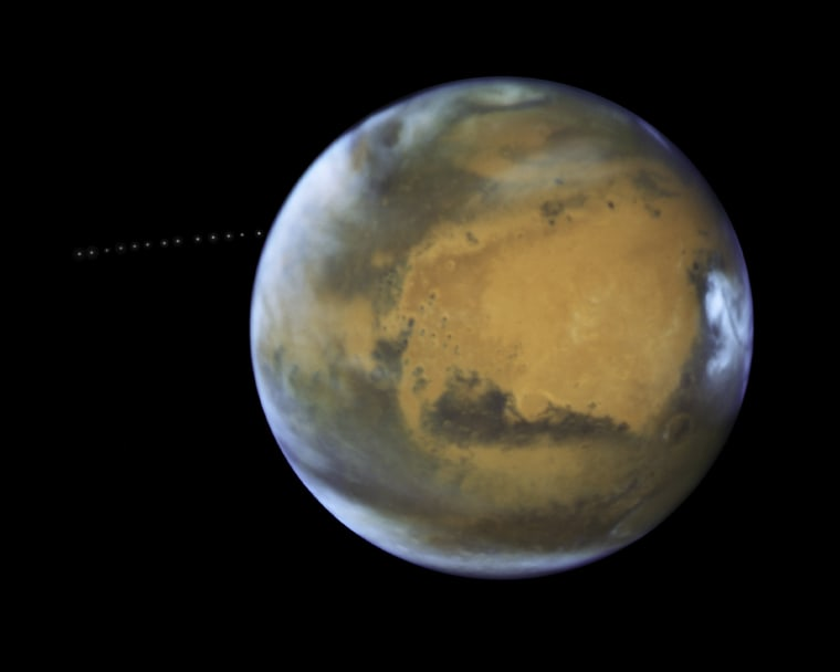 Image: The Tiny Moon Phobos Is Photographed During Its Quick Trip Around Mars
