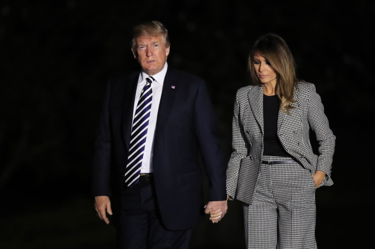 Image: President Donald Trump and first lady Melania Trump return to the White House in Washington