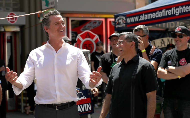 Image: California Lt. Gov. and democratic candidate for governor Gavin Newsom, left, jokes with California attorney general Xavier Becerra
