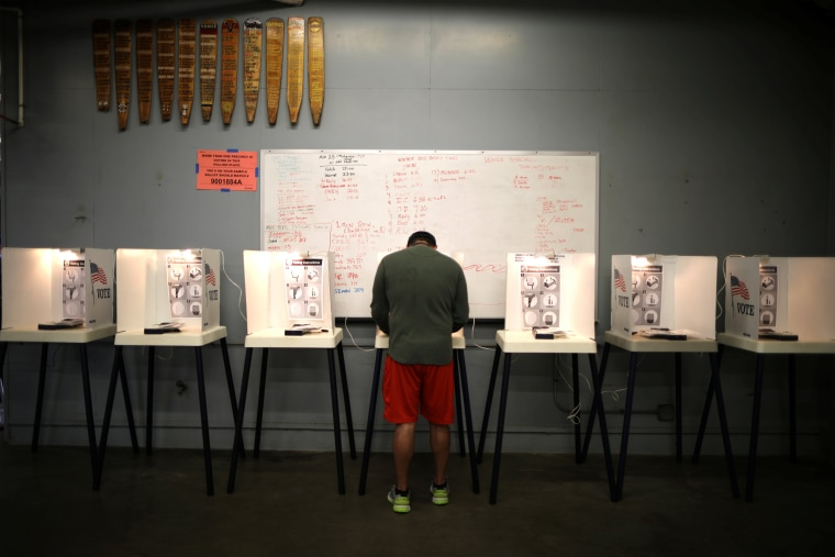 Image: A man votes in the primary election in Los Angeles