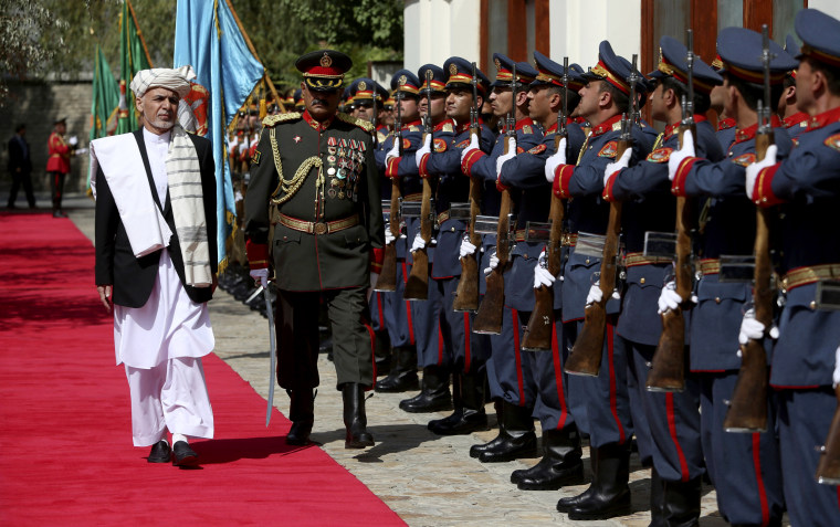 Image: Afghan President Ashraf Ghani inspects an honor guard at the presidential palace in Kabul, Afghanistan, Sept/ 29, 2016.