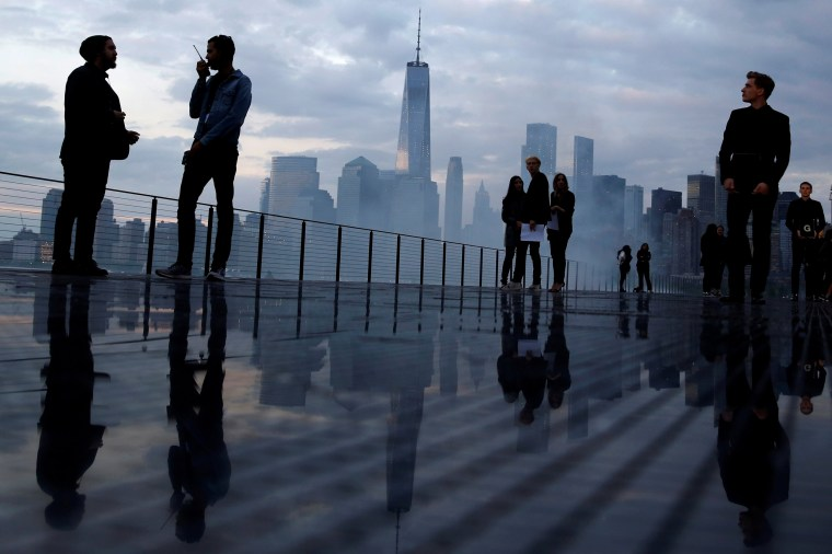 Image: The skyline of downtown Manhattan is seen as people gather on the runway before the Saint Laurent Men's Spring/Summer 2019 collection presentation in New Jersey