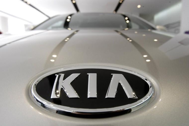 Image: KIA Motors logo on a K7 sedan at a showroom in Seoul, South Korea.