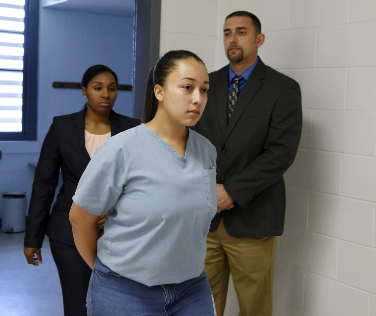 Image: Cyntoia Brown, a woman serving a life sentence for killing a man when she was a 16-year-old prostitute, enters her clemency hearing on May 23, 2018, at Tennessee Prison for Women in Nashville, Tennessee.