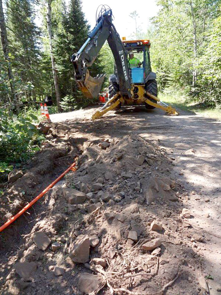 Image: Lake Connections crew burying fiber underground in Blueberry Hill, Minnesota.