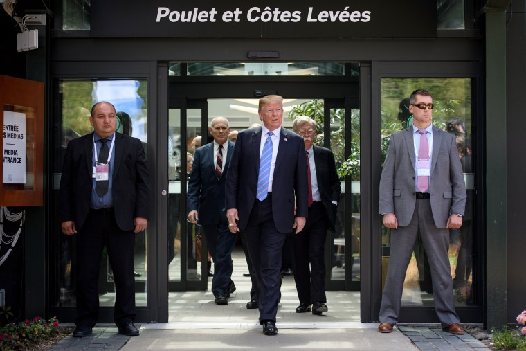 Image: U.S. President Donald Trump leaves with Chief of Staff John Kelly and National Security Adviser John Bolton after holding a press conference ahead of his early departure from the G7 Summit on June 9, 2018 in La Malbaie, Canada.