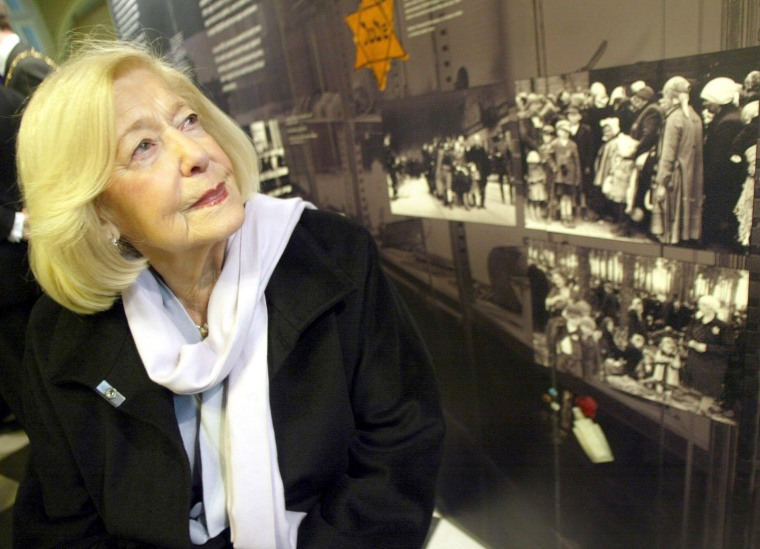 Image: Holocaust survivor Gena Turgel examines a Holocaust memorial board at Belfast city hall, ahead of speaking at the UK's main commemoration for National Holocaust Memorial Day.