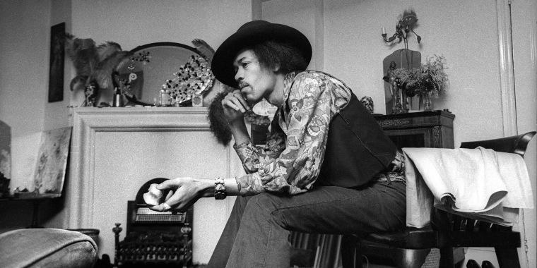 Jimi Hendrix in his home