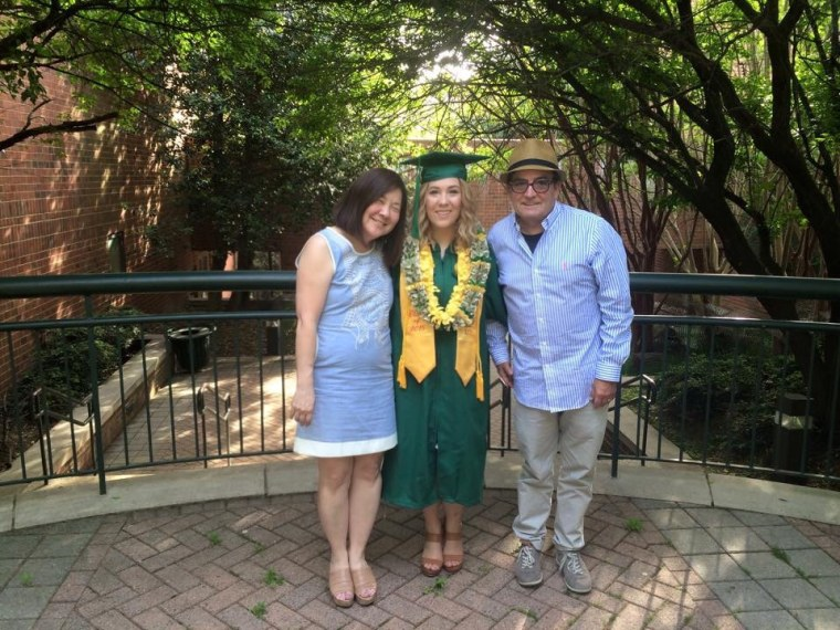 The author with her dad and stepmom at her college graduation; her dad taught her to accept love from all different people, she writes.
