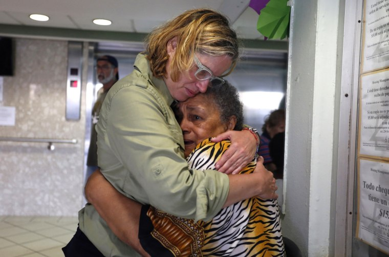 Image: San Juan's Mayor Carmen Yulin Cruz, left, hugs a woman during her visit to a nursing home in San Juan