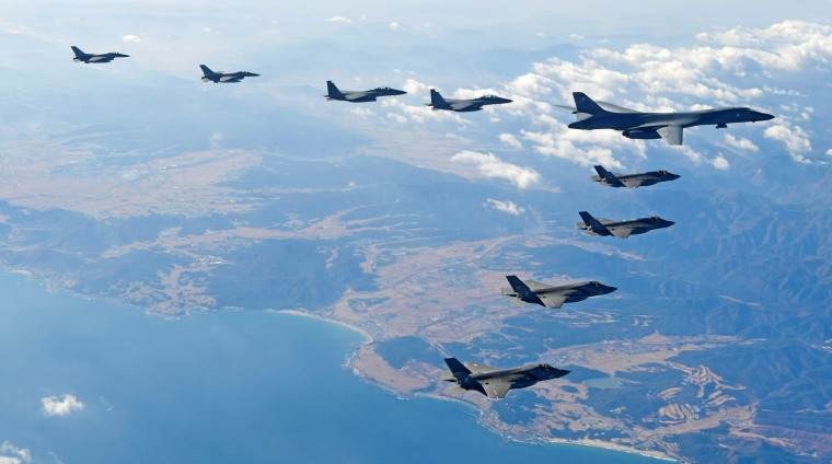 Image: U.S. Air Force B-1B bomber flies in formation during a joint aerial drill between the U.S and South Korea