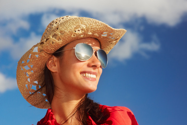 Image: Trendy young woman over the blue sky background