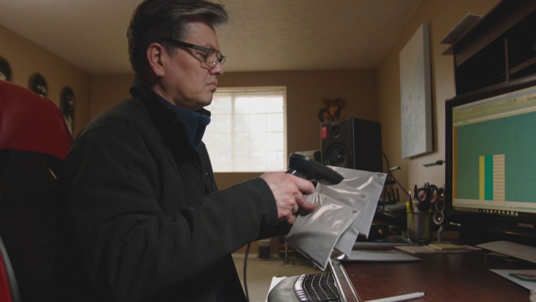 Image: Jimmy Miller scans DNA tests for the children of U.S. soldiers and Vietnamese women