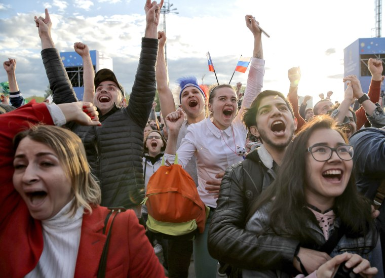Image: Fans celebrate after Russia scored the first goal during the opening match of the World Cup