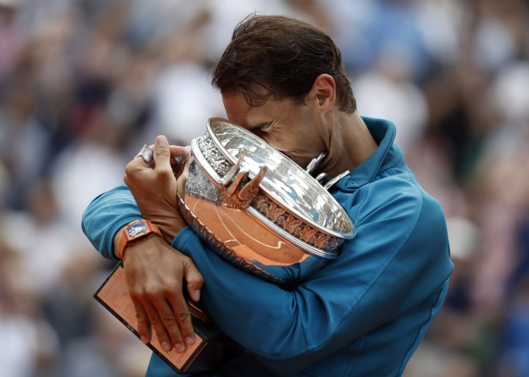 Image: Rafael Nadal of Spain celebrates with the trophy after winning the French Open championship