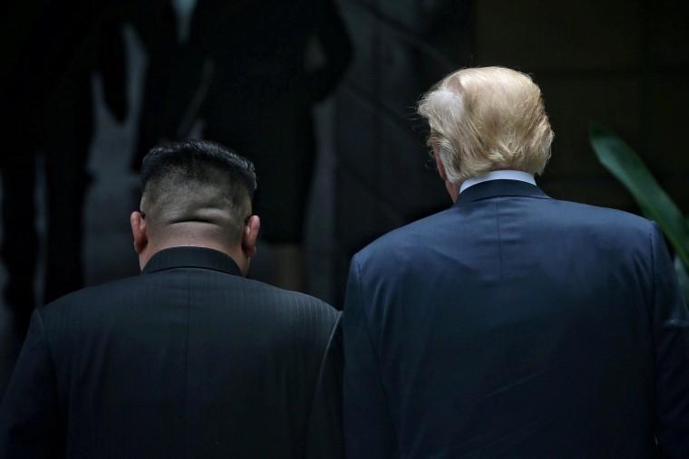 Image: President Donald Trump walks with North Korean leader Kim Jong Un at the Capella Hotel on Sentosa island in Singapore