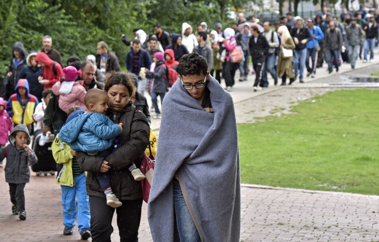Image: Migrants walk from the main station in Dortmund, Germany