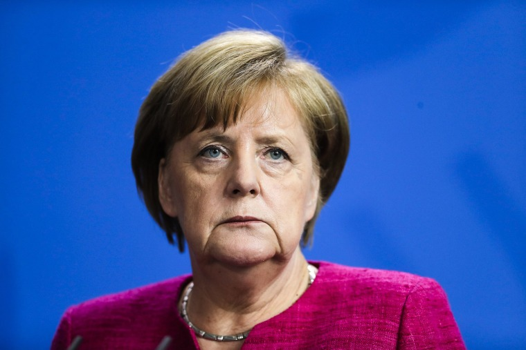 Image: German Chancellor Angela Merkel attends a news conference