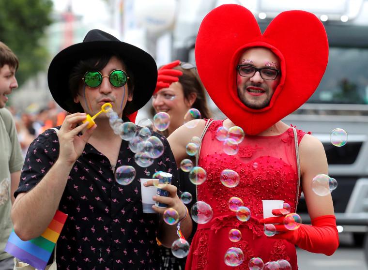 Image: Revellers participate in Regenbogenparade gay pride parade in Vienna