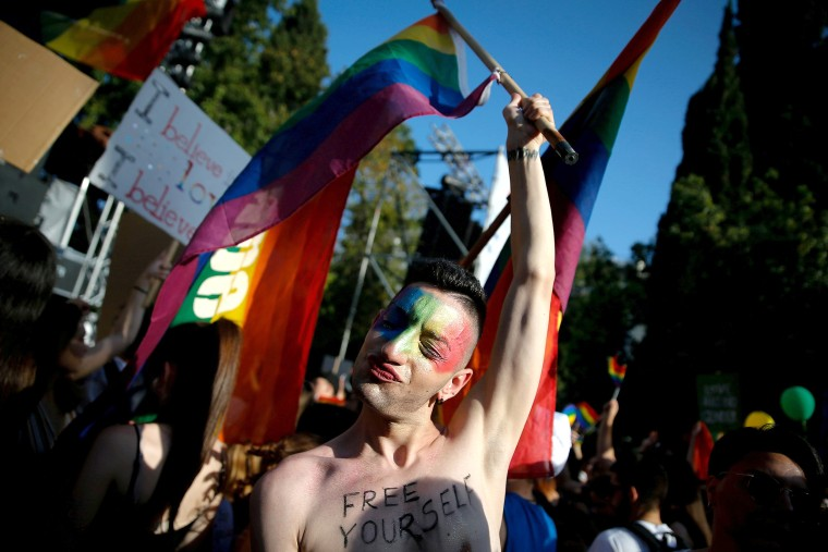 Image: A participant is pictured at a Gay Pride parade in Athens