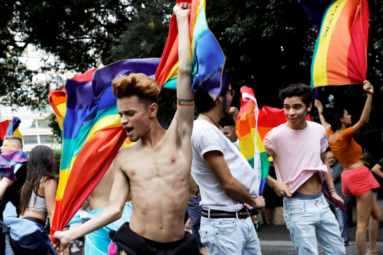 Image: Revellers dance as they take part in the Gay Pride parade along Paulista Avenue in Sao Paulo