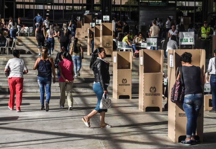 Image: People vote at a polling station during the presidential runoff election in Medellin