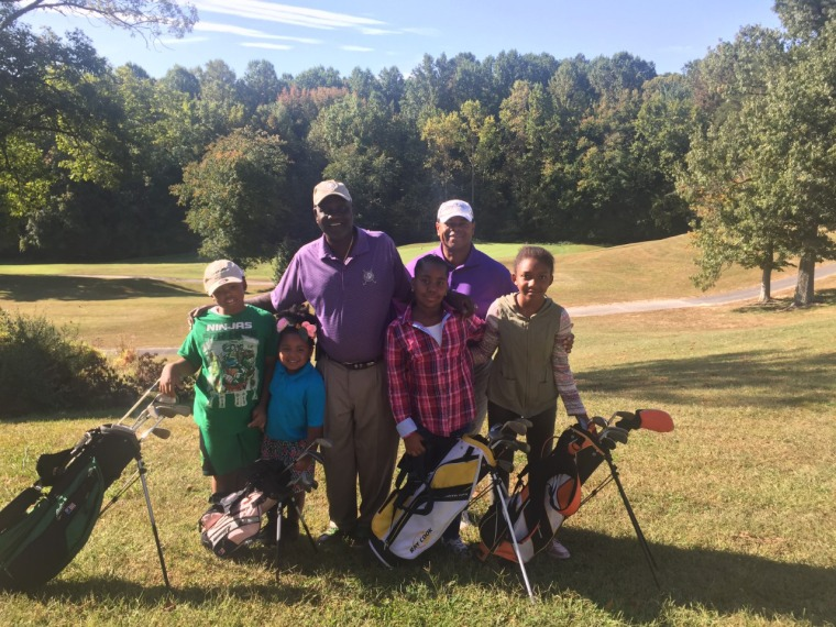 """Image: Craig Kirby, back right, with participants in \""""Golf. My Future. My Game.\"""""""