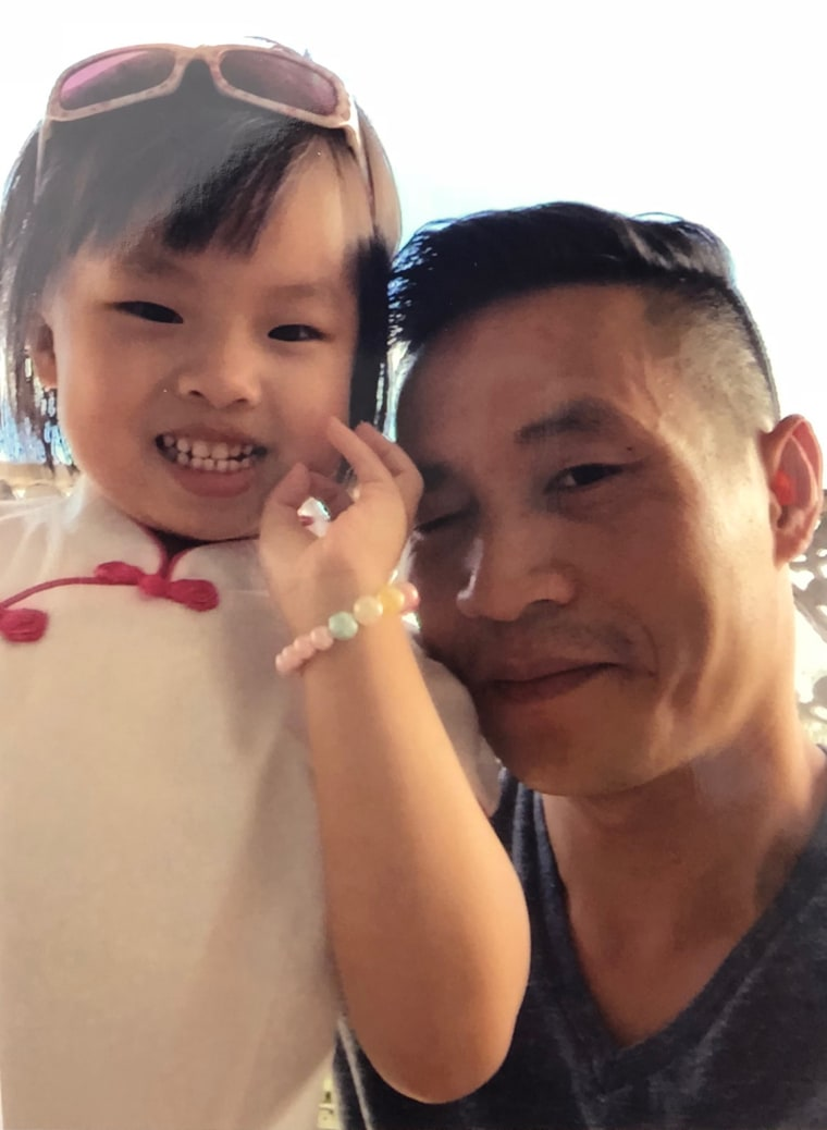 Image: Xiu Qing You with his daughter Mia
