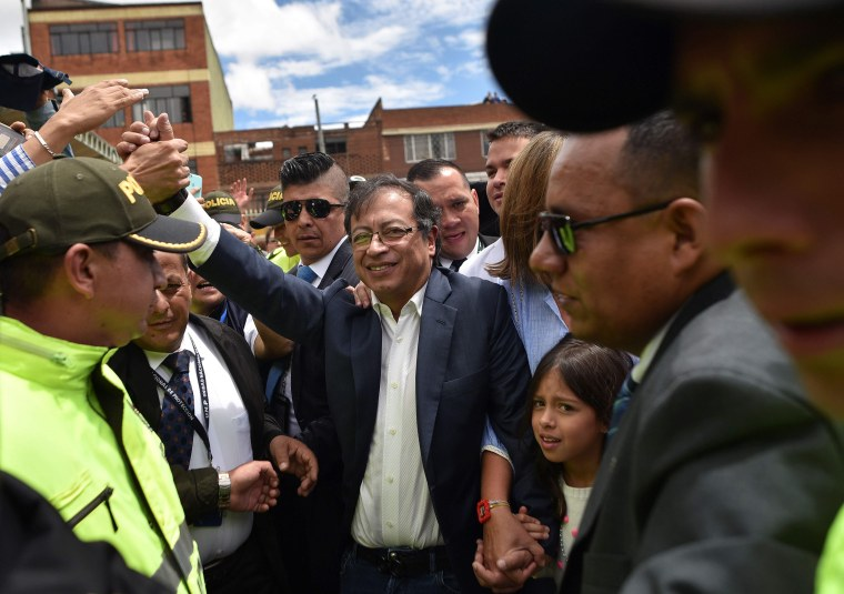 Image: Presidential candidate Gustavo Petro waves to supporters