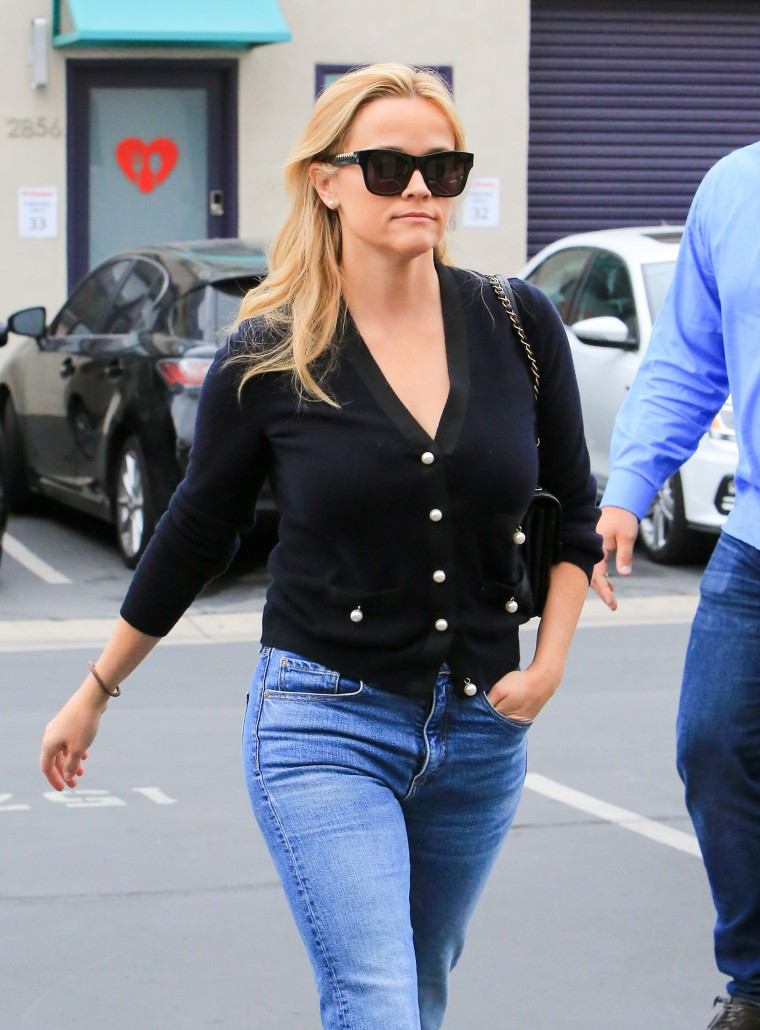 Reese Witherspoon wears black cardigan