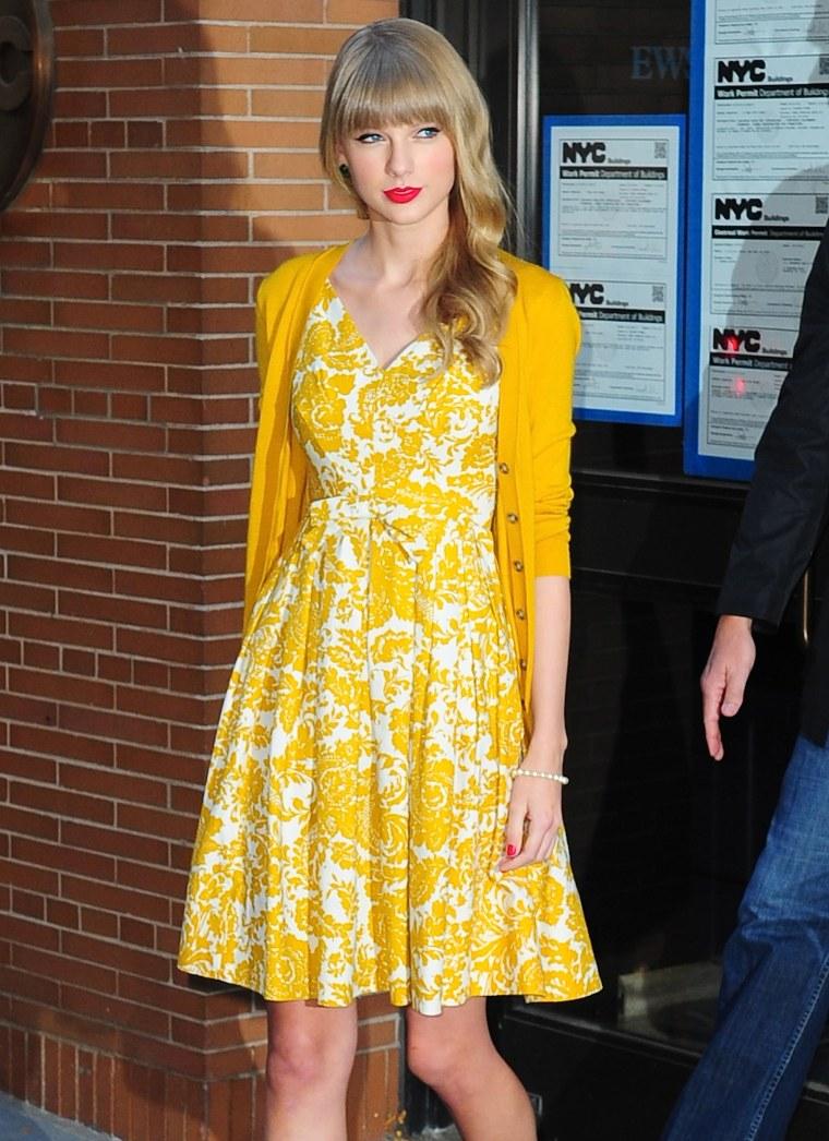 Taylor Swift wears yellow cardigan