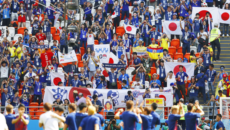 Football fans cheer for the Japanese national football team in Saransk, Russia, on June 19, 2018, ahead of their World Cup group stage match against Colombia.