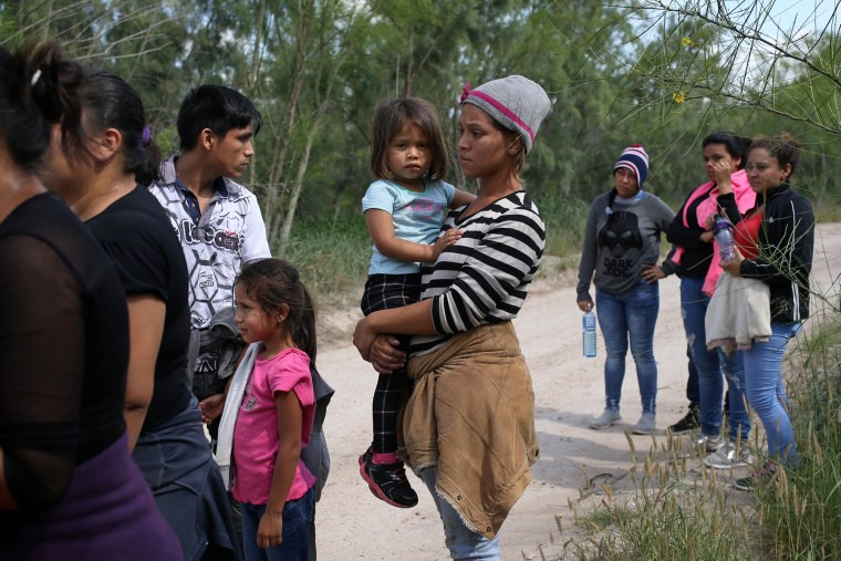Image: Family units who illegally crossed the Mexico-U.S. border turn themselves in to U.S. Border Patrol agents near McAllen