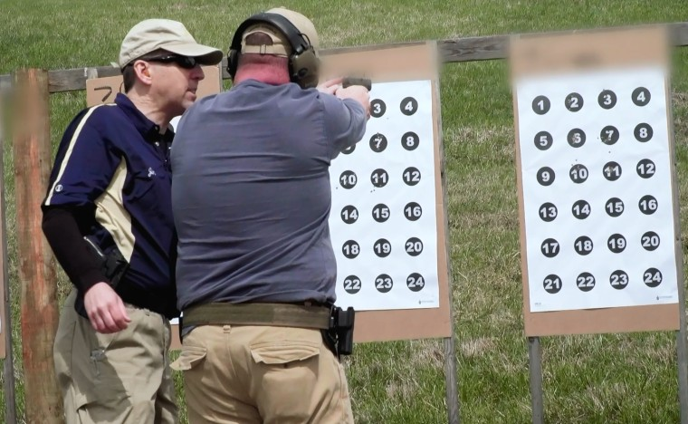 Image: A teacher learns to use a firearm in Newcomerstown, Ohio